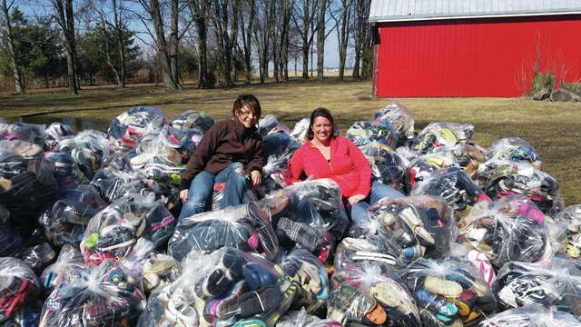 Provided photo More than 160 bags of shoes were collected for Shoes for H.O.P.E., a joint effort between Piqua Kiwanis Club and Missions in Motion. Shown with the donations are Kelly Meckstroth and Niki Watson, Kiwanis Club co-chairs for the project.