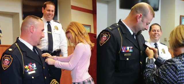 Mike Ullery | Daily Call Chief Bruce Jamison looks on as newly promoted Deputy Police Chief Richard A. Byron, left, receives his new badge from his daughter Kaitlyn, 8, during a ceremony in Piqua City Commission chambers on Tuesday afternoon. Newly promoted Lieutenant Jerry Fogt, left, is pinned with his new rank by his wife Sharon.