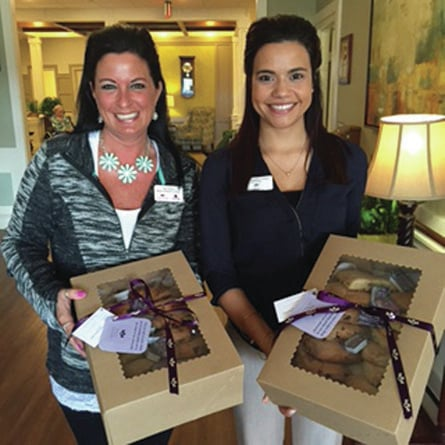 Provided photo Piqua Manor's Stacy Martin, business development coordinator, left, and Taylor Deloney, administrator, will be hand-delivering scones as a thank-you to supportive local businesses in the coming months.