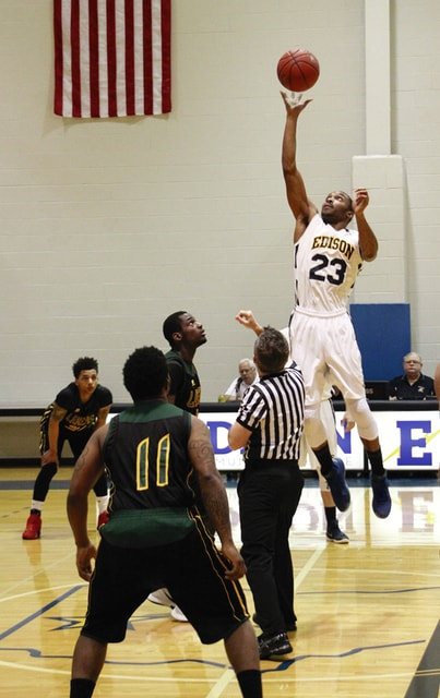 Photo Provided By Edison Community College Malik Thurman wins the tap in a game earlier this season.