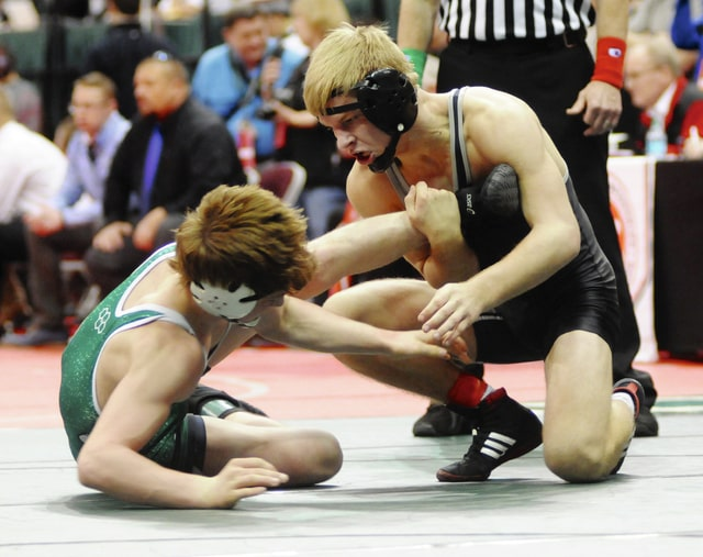 Ben Robinson/GoBuccs.com Covington's Ryan Ford looks to takedown Smithville's Riley Smucker. Ford would finish fourth at 138 pounds in the Division III Individual State Wrestling tournament at the Schottenstein Center.