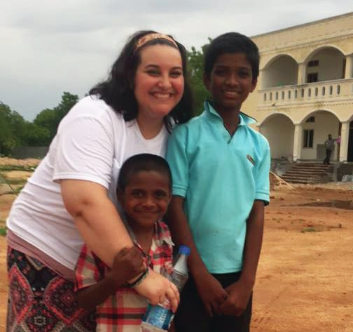Miami East graduate Steph Duff is pictured with two orphaned children, Ravi and Goutham, in the village of Hyderabad, India, in June 2015. Duff recently accepted a career opportunity as the chief storyteller for the Back2Back ministry organization based in Mason, Ohio.