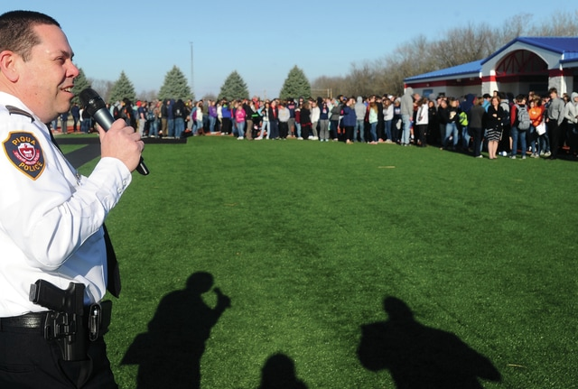 Mike Ullery | Daily Call Chief Bruce Jamison of the Piqua Police Department addresses Piqua High School students gathered at Alexander Stadium on Tuesday morning during a Rapid Evacuation Drill. The state-mandated drills are designed to test the time that it takes students to evacuate the building and gather at designated safe places in the case of an emergency.