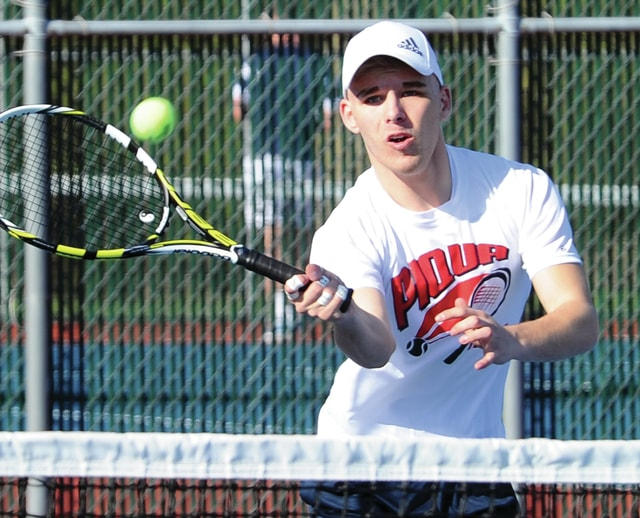 Mike Ullery/Daily Call Piqua's Brendan Tisher hits a forehand volley during a doubles match Tuesday.