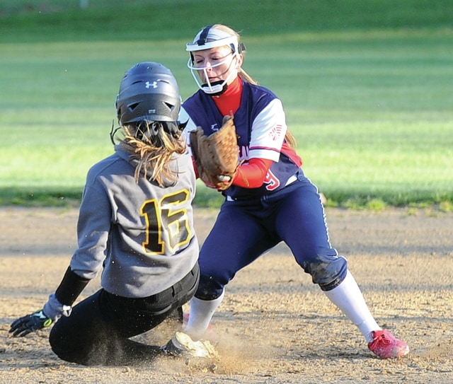 Mike Ullery | Daily Call Alyssa Jones, 9, tags out a Yellow Jackets base runner Tuesday night at Flanagan Sports Complex