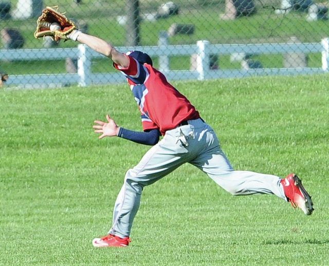 Mike Ullery | Daily Call Piqua centerfielder Cory Cottrell makes a running catch against Sidney at Hardman Field on Wednesday.