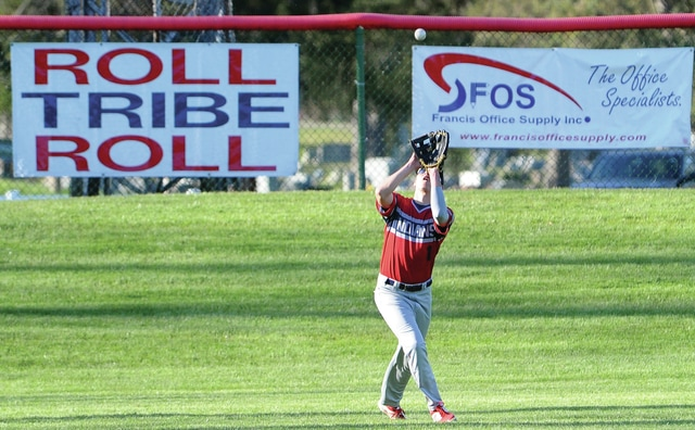 Mike Ullery | Daily Call Noah Lyman, 1, hauls in a fly ball for the Indians.