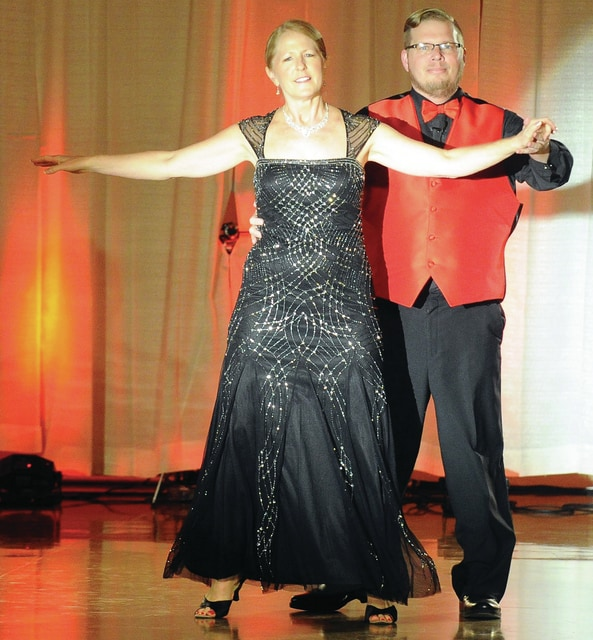 Mike Ullery | Daily Call Adam Jacomet and his pro partner Kristene Clark dance the Foxtrot during the matinee performance of Dancing With the Piqua Stars at A Learning Place on Saturday.