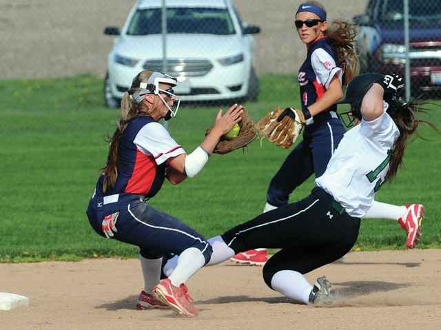 Mike Ullery | Daily Call Piqua shortstop Alyssa Jones looks to put the tag on a Greenville's Lauren Baughn as second baseman Alexis Gordon backs up the play at second.