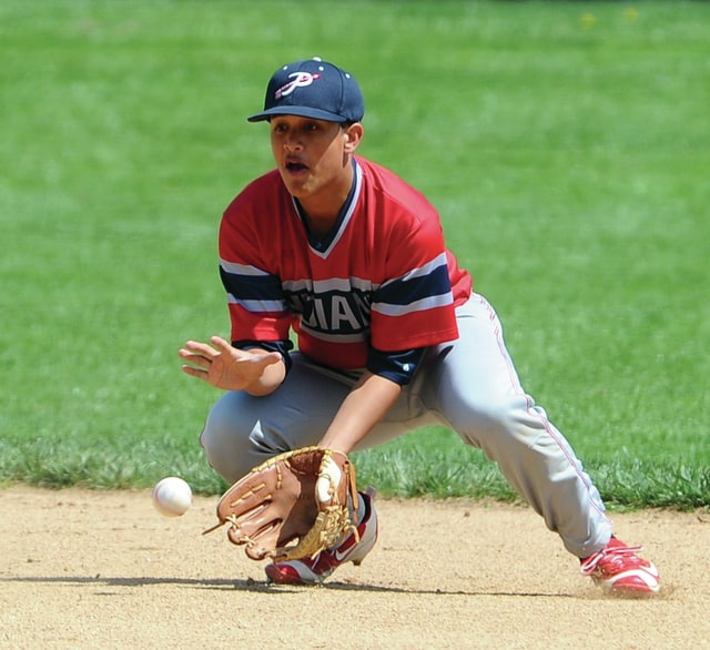 Mike Ullery | Daily Call Piqua second baseman Rupert Delacruz, 4, fields a ground ball.