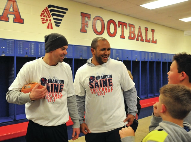 Mike Ullery | Daily Call file photo Former Ohio State Buckeye teammates Dane Sanzenbacher, left, and Brandon Saine answer questions from youngsters attending the Brandon Saine Football Skills Camp at Piqua High School last year.