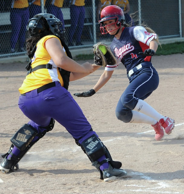 Mike Ullery | Daily Call Alexis Gordon looks to avoid the tag at home plate on Monday against Vandalia-Butler.