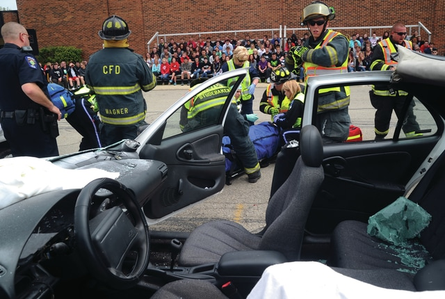 Mike Ullery | Daily Call A mock crash was held at Covington High School on April 27, 2016. The crash was orchestrated to give students a look at the realities of drinking and driving or distracted driving, along with the consequences involved. Following the mock crash students listened to the a mother who lost a son in a crash talk about how the tragedy has affected her life forever. Finally, the young man who was driving the car when her son was killed spoke to students with an impassioned message to avoid drinking and driving.