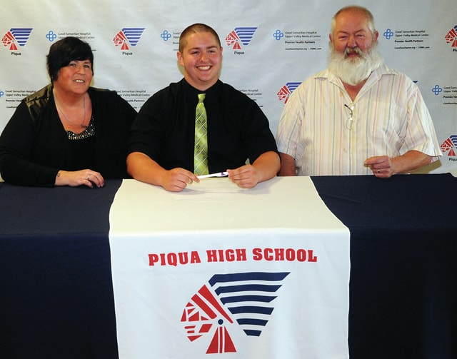 Mike Ullery | Daily Call Piqua senior Noah McGill, pictured with his parents Caleb and Linda, has signed to play football at Wilmington College next season.