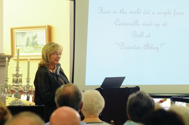 Jane Mitakides shares her story of attending a ball, along with her husband, at Highclere Castle, in England, home of the popular television series Downton Abbey, on Thursday evening as part of the Piqua Public Library Around the World series. The event was sponsored by Friends of the Piqua Public Library.