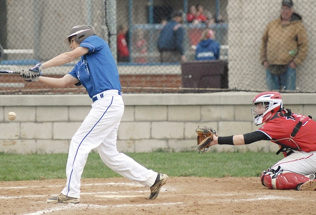 Anthony Weber/Troy Daily News Miami East's Colton Purves follows through on a swing as Newton catcher Rhett Gipe awaits the pitch Wednesday at Miami East.