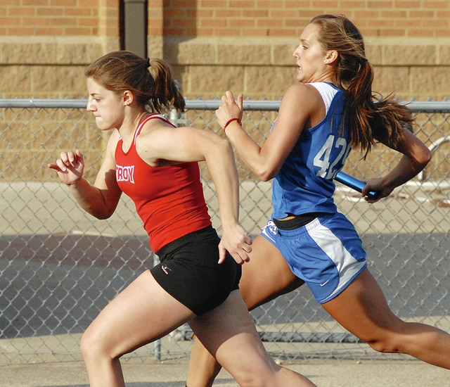 Anthony Weber/Civitas Media Miami East's Jillian Wesco (right) runs a relay Tuesday.