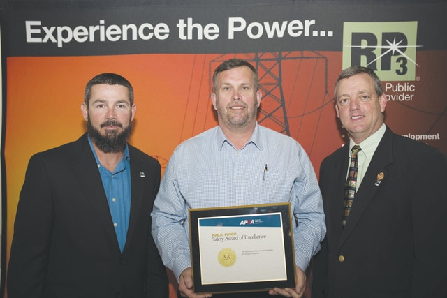 Bob Bowman, assistant director of operations for the Piqua Power System (center) receiving the APPA Safety Award of Excellence from Aaron Haderle, chair of the APPA Safety Committee and supervisor at Kissimmee Utility Authority (left) and Mike Hyland, APPA senior vice president of engineering services (right).