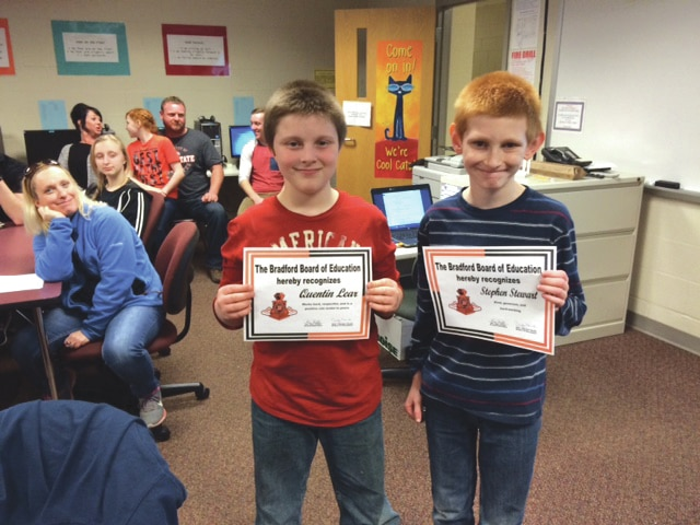 Provided photo Bradford students Quentin Lear and Stephen Stewart proudly display their certificates for Student of the Month. Not pictured is Kira Snyder.