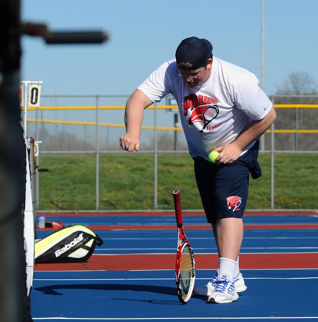 Piqua's varsity singles players, Tyler Lavey, Josh Hanes, and J.J. Rohrbach in action against Springfield in a home match on April 15, 2016.