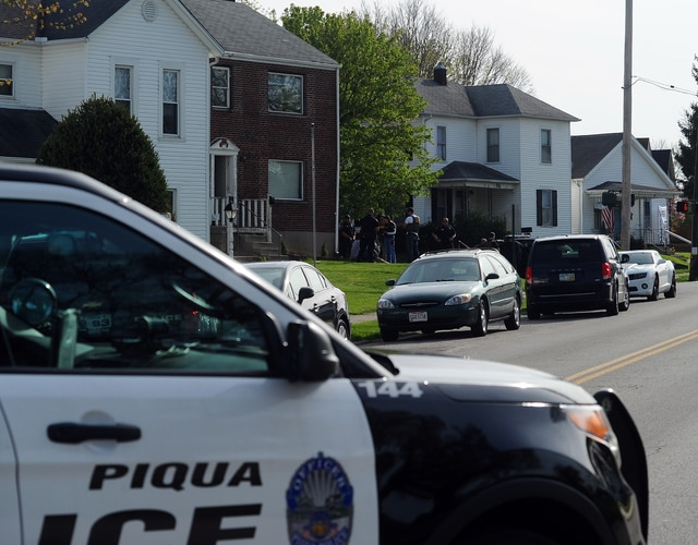 Piqua police assist the FBI in apprehending a fugitive at 921 South Street on April 24, 2016.