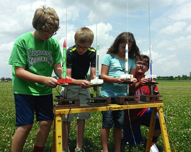 Students, including Grant Klopfenstein of Troy, Ethan Derryberry of Sidney, Rachael Johnson of Troy and Isaac Cupp of Troy, participate in a past Rocket Day.