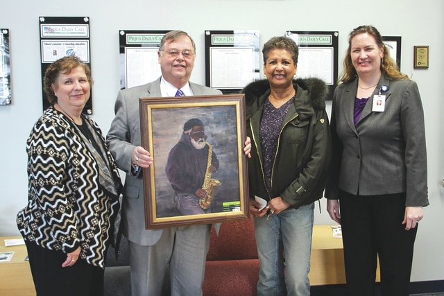 Provided photo Stan Evans, second left, vice chairman of the Edison State Community College Foundation Board, recently donated a piece of artwork to the college's music education department. The oil painting, a portrait of a jazz musician by Piqua artist Linda Hamilton, second right, will be on display in the west hall of Edisonճ Piqua campus. Also pictured are music instructor Gail Ahmed, left, and Dean of Arts and Sciences Naomi Louis, right.