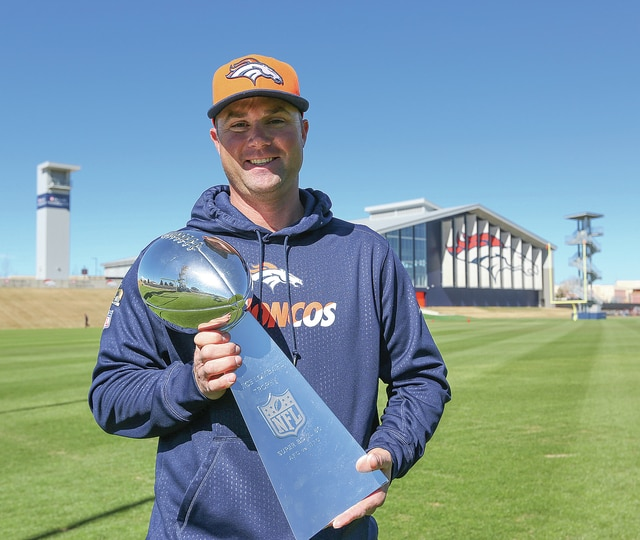 Photo Courtesy of the Denver Broncos Piqua High School graduate Brooks Dodson holds the Super Bowl 50 Lombardi Trophy, recently won by the Denver Broncos. Dodson is the Broncos' Director of Sports Turf and Grounds,
