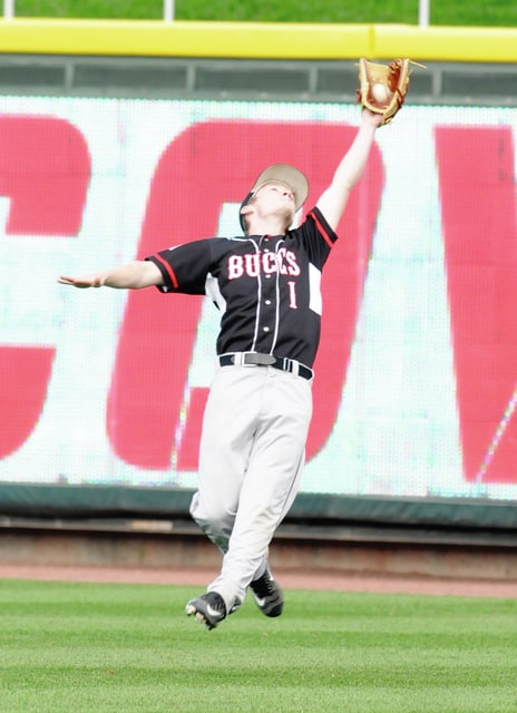 """<p style=""""text-align:right;"""">Covington right fielder Levi Winn makes a leaping catch to end the fifth inning Friday at Fifth-Third Field."""