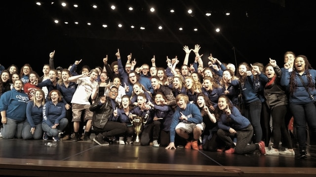 "Provided photo Members of ""The Company,"" Piqua High School's show choir, celebrate their Grand Championship win at the Wapakoneta Music and More Invitational on April 9. This was The Company's first Grand Champion win in four years."