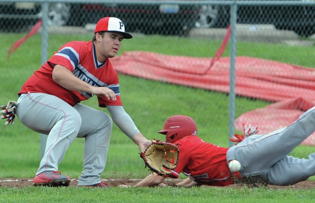 Mike Ullery | Daily Call Austin Davis, 3, looks to put the tag on a Trojan base runner.