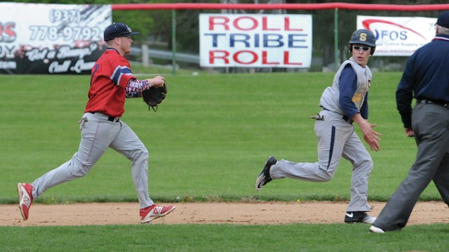 Mike Ullery/Daily Call Piqua third baseman Logan Harris chases Springfield's Dominic Manier in a rundown between second and third Thursday at Hardman Field.