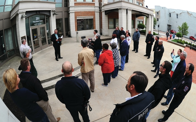 Mike Ullery | Daily Call Gary Wagner, top left, pastor at Piqua Pentecostal Church, addresses those who gathered at the Piqua Municipal Building on Thursday to celebrate National Day of Prayer.