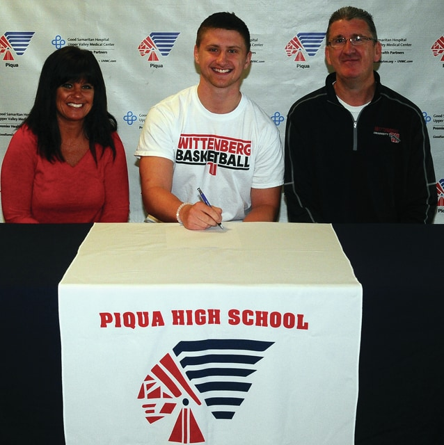 Mike Ullery | Daily Call Piqua senior Colton Bachman signed his National Letter of Intent to play both football and basketball for Wittenberg University. Pictured with Bachman are his parents Anita and Kirk.