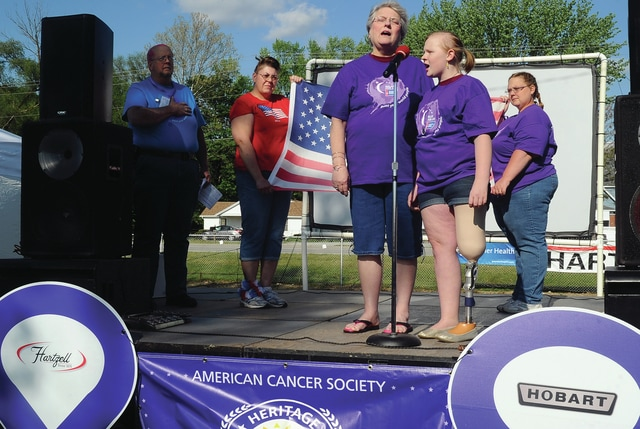 Mike Ullery | Daily Call Piqua Junior High School student Mikayla Nelson and her grandmother Sheila Nelson perform the National Anthem to kick off the 2016 Miami County Relay for Life event at the Miami County Fairgrounds on Friday evening.