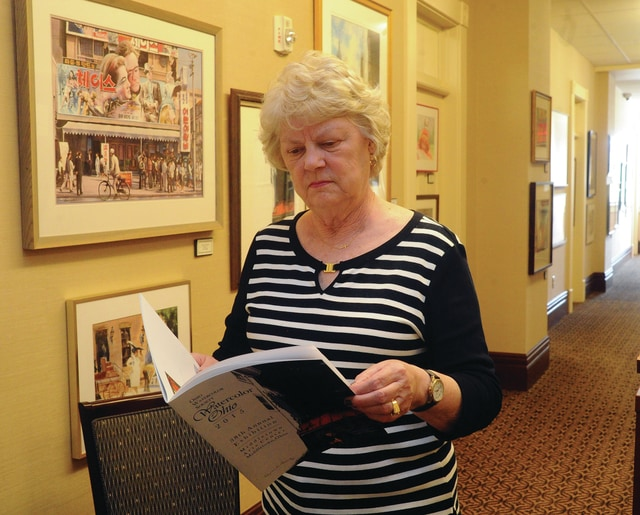 Mike Ullery | Daily Call Friends of the Piqua Library volunteer Ruth Koon talks about some of the entries in the Ohio Watercolor Society show <em>Watercolor Ohio 2015</em>. The pieces will be on display at the Piqua Public Library through the 27th of May during regular library hours. The show is sponsored by Friends of the Piqua Library and the Piqua Public Library.