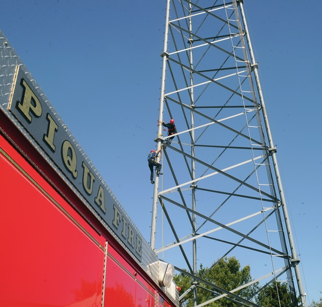 Mike Ullery | Daily Call Piqua firefighters spent Wednesday honing their tower rescue techniques on the tower at Pioneer Electric on US 36. Proper climbing procedures began the day followed by victim rescue.