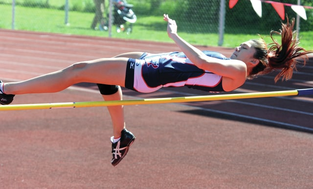 Mike Ullery | Daily Call Piqua's Ashley Ho clears the bar on her way to a second-place finish in Division I District high jump at Wayne High School on Wednesday.