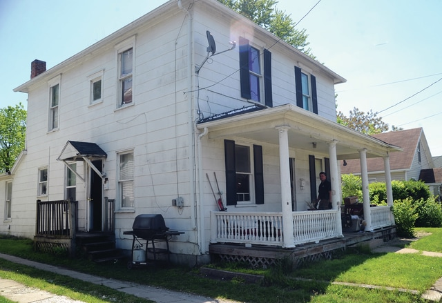 Mike Ullery | Daily Call Piqua police offers execute a search warrant this morning at 741 and 741 1/2 South Main Street in Piqua.