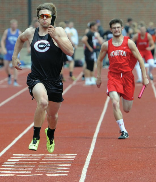 Mike Ullery | Daily Call Covington's Brandon Magee edges out Houston's Zach McKee in the boys 4x100 meter relay.