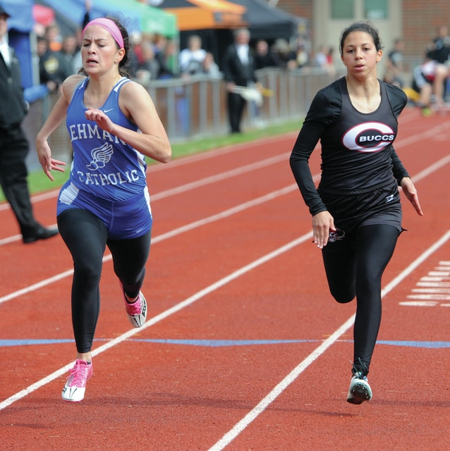 Mike Ullery | Daily Call Alanna O'Leary of Lehman and Breanna Kimmel of Covington head for the finish line in the girls 100 meter dash event.