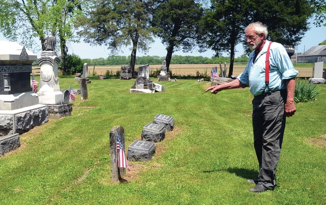 Mike Ullery | Daily Call Steve Greggerson of the John Johnston Farm & Indian Agency points out one of the many graves of veterans buried at the historic Johnston Family Cemetery, which sits adjacent to the John Johnston Farm & Indian Agency. It is not only the final resting place to members of Col. John Johnston's family but a number of other war veterans, ranging from Revolutionary War era to World War II.