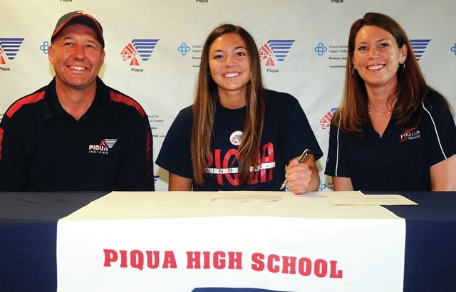 Mike Ullery | Daily Call Piqua senior Megan Anderson, center, signs her National Letter of Intent to play softball for Sinclair Community College next season, during a signing ceremony at Piqua High School on Tuesday evening. Anderson is pictured with her parents Shawn and Deana.
