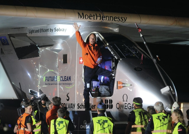 Mike Ullery | Daily Call Pilot Bertrand Piccard waves to onlookers as he boards Solar Impulse 2 at 2:20 a.m. on Wednesday morning to begin the next leg of the team's attempt to become the first to fly around-the-world in a solar-powered airplane. The teams next stop is LeHigh, Pennsylvania.