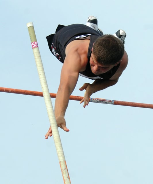 Mike Ullery | Daily Call Jett Murphy of Covington clears the bar on his was to a first place finish in boys Division III pole vault.