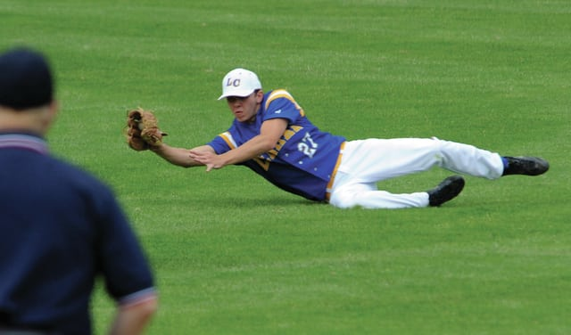 Mike Ullery | Daily Call Lehman right fielder Ian Smith, 27, makes a diving catch for the final out of the game.