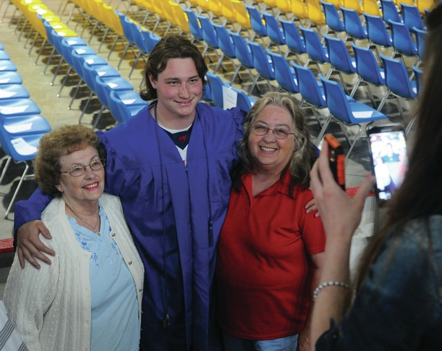 Mike Ullery | Daily Call Nathan Hampton of Piqua poses for Heaven Curtis to take a photo with his great-grandma Jeanie Langston and his grandma Vickie Hampton before Thursday's Upper Valley Career Center Convocation at Hobart Arena in Troy.