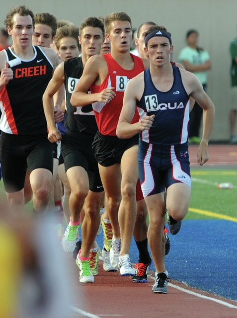 Mike Ullery | Daily Call Piqua's Andy Mayse leads the pack early in the boys 1600 meter run.