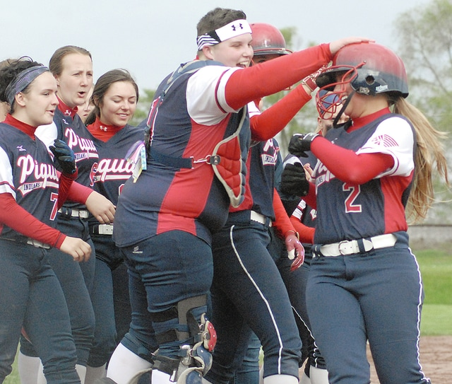 Anthony Weber/Civitas Media Piqua's Kendra Forness (2) is mobbed at home plate after her second inning home run Tuesday.