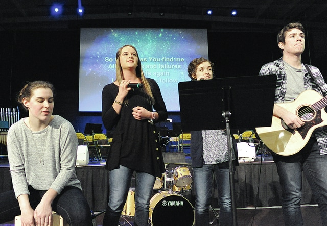 """Anthony Weber   Troy Daily News Troy Christian High School students Jenna Grady, Hailey Isenbarger, Bekah Landfair and Tom Null lead worship with songs including """"Mighty to Save"""" during the 2016 National Day of Prayer held at the school Thursday."""